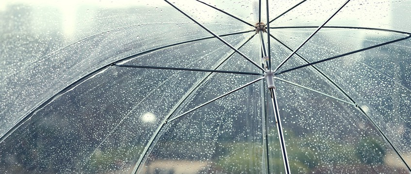 Transparent umbrella in rainy day